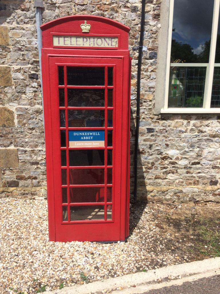 Discovering Dunkeswell Abbey red phone box display Devon